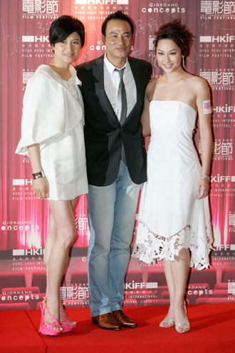 Hong Kong actors Maggie Siu (L), Simon Yam (C) and Kate Tsui pose during the gala premiere of their movie