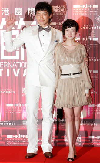 South Korea's actress Lim Su-jeong (R) and actor Jung Ji-Hoon, also known as Rain, attend the gala premiere of their movie