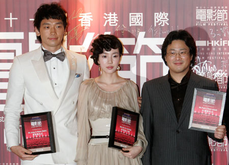 South Korean director Park Chan-wook (R), actress Lim Su-jeong (C) and actor Jung Ji-Hoon, also known as Rain, attend the gala premiere of their movie