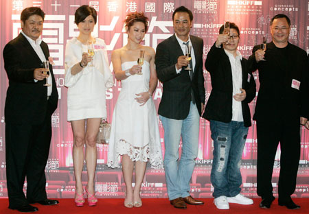 (From L) Hong Kong actors Lam Suet, Maggie Siu, Kate Tsui, Simon Yam, director Yau Nai Hoi and producer Johnnie To toast during the gala premiere of their movie