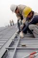 图文:中国农业大学体育馆 工地工人正在施工