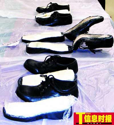 图为运毒人用以藏毒的夹层皮鞋。摄影 郭柯堂 黄伟德 吴卓航