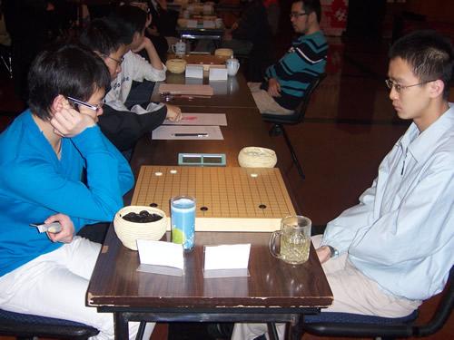 刘星(左)对阵李康