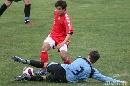 图文:[国奥]中国2-1乌拉圭 王小龙遭遇铲断