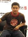 图文:前国乒名将做客搜狐华奥 刘国正面带微笑