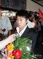 图文:国乒载誉抵达北京 郭跃平静面对媒体采访