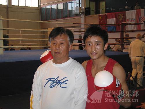 邹市明和国家拳击总教练张传良
