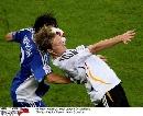 图文:德国2-1斯洛伐克 扬森争顶头球