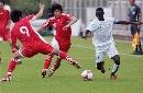 图文:国奥点球淘汰科特迪瓦 围堵对手科阿西