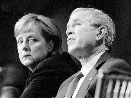 默克尔和布什暗中斗气