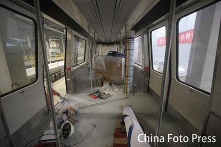 """图文:首都机场""""中国印""""火车亮相 车厢内部图"""