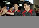图文:中国羽毛球队凯旋 蔡�S和付海峰挥手
