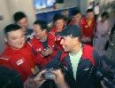 图文:中国羽毛球队载誉归来 李永波和同事