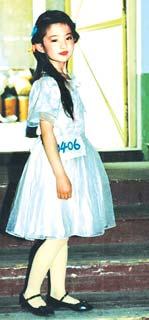 小时候的刘亦菲是个美人胚子。(资料图片)