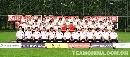 图文:国足出征亚洲杯全家福 团结奋进无坚不摧