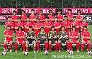 图文:国足出征亚洲杯全家福 齐心协力争取胜利