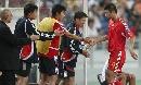图文:[亚洲杯]中国5-1大马 韩鹏教练组击掌相庆