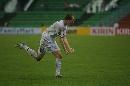 图文:[亚洲杯]中国0-3乌兹 盖因里希庆祝第三球