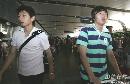 图文:[亚洲杯]国足抵京 赵旭日和朱挺
