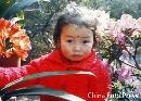 组图:陈涛儿时私密照片曝光 穿女衣成可爱女孩