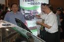 图文:中国体育用品博览会 刘鹏参观汽车展台