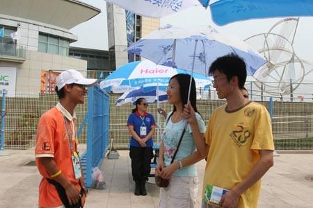 老志愿者传经新志愿者 赛事服务经历值得铭记