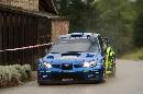图文:[WRC]勒布称雄德国站 驶过一幢小屋