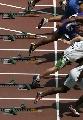 图文:男子100米预赛 发令枪响众选手如箭离弦