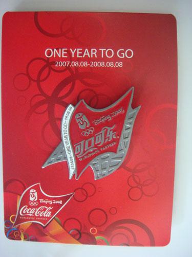 图文:奥运欢乐汇拍品之一 可口可乐奥运纪念章