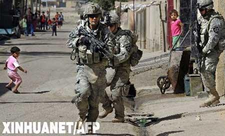 驻伊美军当天将本周伊拉克发生的一系列爆炸事件归罪于基地组织.