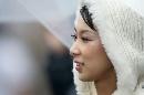 图文:[F1]日本大奖赛美女 风雨中的美丽