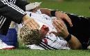 图文:[欧预赛]德国VS爱尔兰 小猪受伤倒地