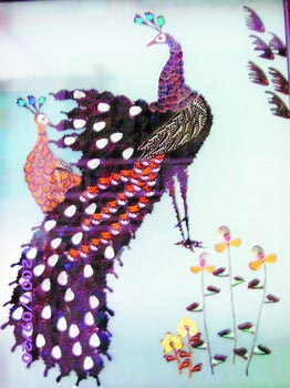罗恒制作的蝴蝶画栩栩如生。杨元崇摄