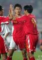 图文:[资格赛]国足7-0缅甸 三将庆祝胜利