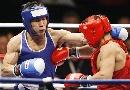 图文:拳击世锦赛第十日 哈那提击中对手腋下
