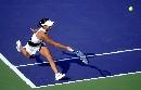 图文:李婷获六城会网球女子单打冠军 底线回球