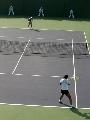 图文:女单决赛李婷2-0周弈妙 两人在底线对峙