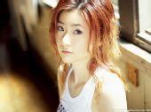 图文:[乒乓球]四元奈生美写真 阳光下光滑皮肤