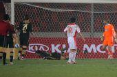 图文:[友谊赛]国奥1-1科特布斯 朱挺头球破门