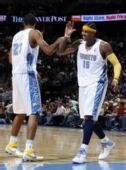图文:[NBA]雄鹿负掘金 安东尼坎比击掌
