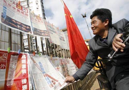 常新成/2008年1月10日,来自江苏泰州的奥运火炬手残疾人常新成在海口...