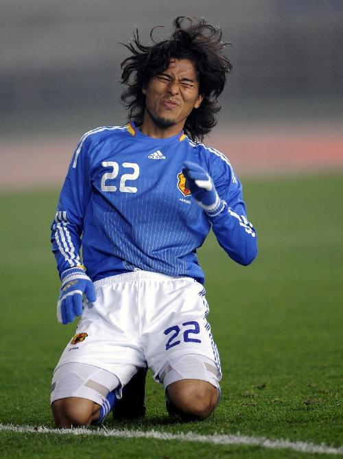 ...2月23日,日本队球员中泽佑二在比赛中.当日,在重庆进行的男...