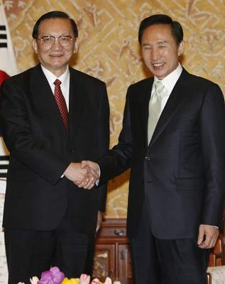 李明博与中国国务委员唐家璇会面