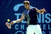 图文:网球频道赛1/4决赛 小将德里奇肌肉健硕
