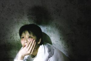 小王对自己的手术充满期待 本报记者 赵锐 摄
