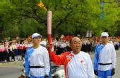 图文:奥运火炬平壤传递 火炬手传递63