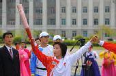 图文:奥运火炬平壤传递 火炬手传递68