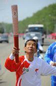 图文:奥运火炬平壤传递 火炬手传递7