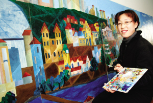 周清正在创作巨幅油画作品《今日青岛》。