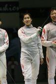 图文:亚锦赛中国女花团体折桂 剑客互开玩笑